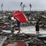 Two dead as powerful typhoon clips Luzon