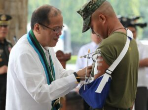 President Benigno S. Aquino III, assisted by Defense Secretary Voltaire Gazmin, confers the Distinguished Conduct Star, Distinguished Service Star and Gold Cross Medal to the awardees during the Flag Raising and Awarding Ceremony at the GHQ Canopy, Camp General Emilio Aguinaldo in Quezon City on Monday (November 04, 2013). The Commander-in-Chief honors the men in uniform who gallantly fought to rescue civilian hostages from the Moro National Liberation Front (MNLF) – Misuari faction during the three-week Zambonga City siege last September. (MNS photo)
