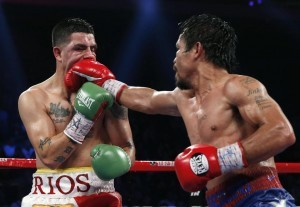 Manny Pacquiao (right) from the Philippines, right, lands a right to Brandon Rios of the United States during their WBO international welterweight title fight Sunday, Nov. 24, 2013, in Macau. Pacquiao defeated Rios by unanimous decision on Sunday to take the WBO international welterweight title and return to his accustomed winning ways after successive defeats. (MNS photo)