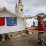 Typhoon survivors turn cave-dwellers