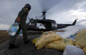 A Philippine Air Force helicopter is loaded with water at Tacloban airport, ahead of being deployed to a mountainous area inaccessible for vehicles to the west of Tacloban city, in the central Philippines November 17, 2013. The Philippine and U.S. Air Forces are flying rice, clothes and drinking water into remote areas of the central Philippines, which are unreachable by vehicles. A massive relief effort is finally kicking into gear, nine days after one of the most powerful typhoons on record wreaked havoc across the impoverished area in the central Philippines with monster winds and a deadly storm surge of sea water. Philippine authorities and international aid agencies face a mounting humanitarian crisis, with the number of people displaced by the catastrophe estimated at 4 million, up from 900,000 late last week (MNS photo)
