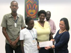 Haiti Farmers Donation. Eliette Pierre (in white shirt) and members of the Smallholder Farmers Alliance in Gonaives, Haiti, present a check for $150 representing their assistance for farmers in the Philippines displaced by Typhoon Haiyan.