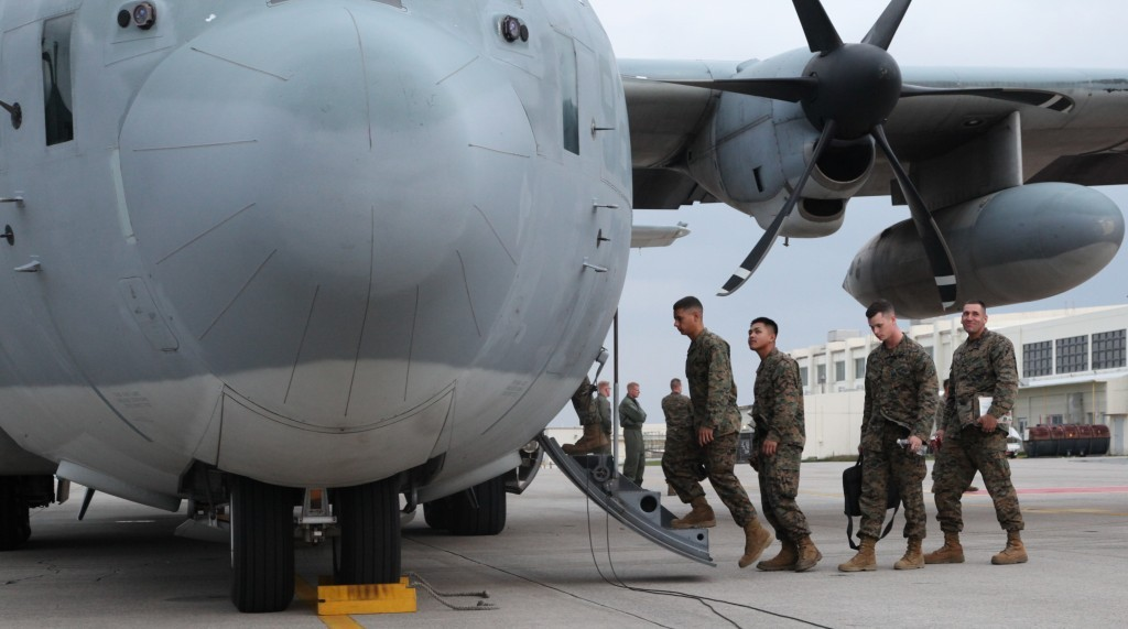 U.S. Marines board a KC-130J Hercules aircraft at Marine Corps Air Station Futenma, Okinawa, Japan, to depart for humanitarian assistance and disaster relief operations in the Philippines following Typhoon Haiyan, Nov. 11, 2013. The Marines are assigned to the 3rd Marine Expeditionary Force. U.S. Marine Corps photo by Lance Cpl. David N. Hersey