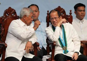 President Benigno S. Aquino III converses with Defense Secretary Voltaire Gazmin during the Joint Graduation of the Major Services Pre-Entry Officer Courses at the Camp General Emilio Aguinaldo in Quezon City on Monday (November 25, 2013). (MNS photo)