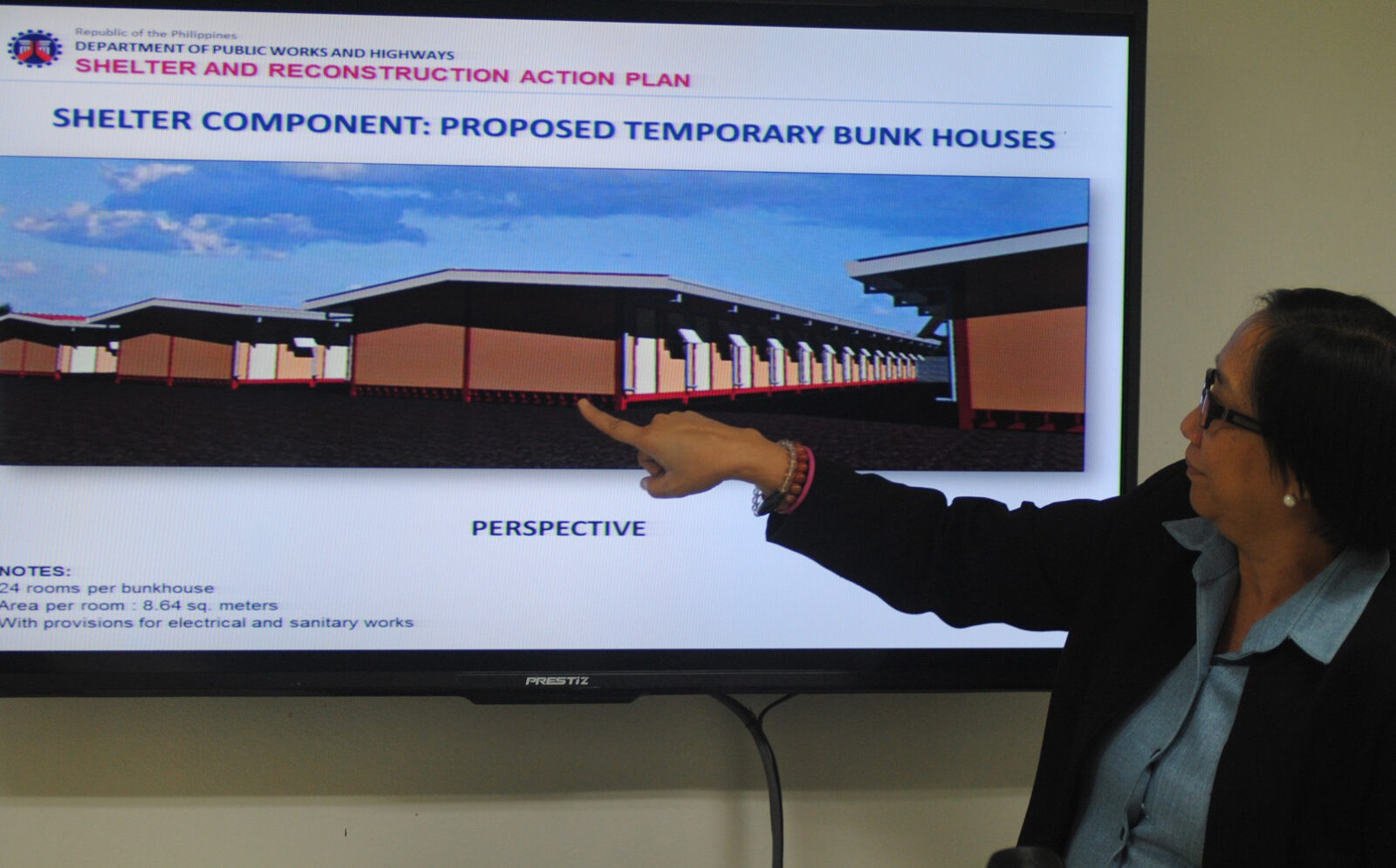 Department of public work and Highways (DPWH) OIC-Director Beth Pilorin shows the scale model for the construction of temporary shelter for families affected by super typoon 'Yolanda' in Samar and Leyte on Tuesday (November 26, 2013) at the DWPH head office in Port Area, Manila. DPWH Secretary Rogelio Singson said works are on-going for the construction of bunkhouse units in 4 sites in Tacloban City, Palo (Leyte), and Basey and Marabut towns in Samar. (MNS photo)