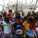 Defiant typhoon survivors welcome Christmas