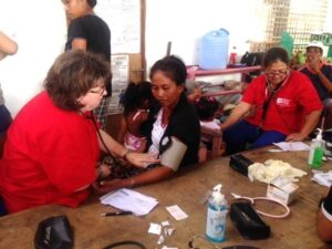 NRN members at work in evacuation center in Estancia. More than 2,000 have been forced from their homes.