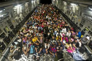 Tacloban residents displaced by Typhoon Haiyan fill the cargo hold of a C-17 Globemaster aircraft during Operation Damayan before departing from Tacloban, Philippines, Nov. 22, 2013. U.S. Navy photo by Petty Officer 1st Class Peter D. Blair