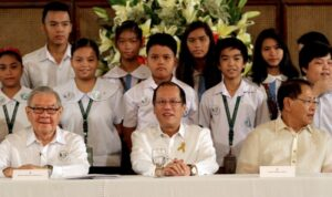 President Benigno S. Aquino III shares the stage with the students from the Center for Excellence (CENTEX) Elementary School for a group photo souvenir during the ceremonial signing of Republic Act No. 10533 or the Enhanced Basic Education Act of 2013 at the Rizal Ceremonial Hall of the Malaca?n Palace on Wednesday (May 15). The K to 12 program covers Kindergarten and 12 years of basic education (six years of primary education, four years of Junior High School, and two years of Senior High School) to provide sufficient time for mastery of concepts and skills, develop lifelong learners, and prepare graduates for tertiary education, middle-level skills development, employment, and entrepreneurship. In photo are House Speaker Feliciano Belmonte, Jr., and Senator Edgardo Angara. (MNS photo)