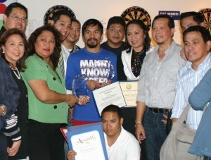OC FIL-AM CHAMBER POWER YEAR: The Filipino American Chamber of Commerce of Orange County has lined up power events this year in the pursuit of its goals for the Fil-Am entrepreneurs and professionals in one of the most populous counties in the U.S.  In this file photo are some of the officers and members after presenting the Maharlika Award to Filipino boxing champion, Manny Pacquiao, in the recent past.