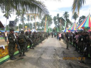 Bangsamoro soldiers, in full battle gear, keep an eye on Muslim delegates during a Bangsamoro Leaders Assembly held in July 2012 in Sultan Kudarat, Maguindanao. Muslim rebels have been fighting the government since the 70s with thousands killed from both  sides. Now, both parties hope that a new peace treaty bring lasting peace in the troubled region.