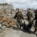 100s of corpses in Tacloban unburied after Yolanda