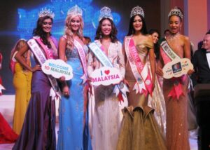 Miss Tourism International 2013/2014 Angeli Dione Gomez (center) is flanked by fellow winners at the end of the pageant coronation night held at the Marriot Hotel and Spa in Putrajaya.