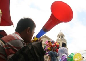 "A boy peddles his ""torotot"" or horn in Quiapo to celebrate the New Year. Although the Department of Health has been urging the public to create noise by blowing horns instead of lighting firecrackers during the celebration, hundreds still suffer from injuries caused by firecrackers and other pyrotechnics in the Philippines. (MNS photo)"
