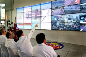 President Benigno S. Aquino III watches the Video Launching of the new Metropolitan Manila Development Authority (MMDA) Traffic Signalization System and Command and Control Center at the new MMDA Command and Control Center in Orense Street, Guadalupe Nuevo, Makati City on Wednesday (Jan. 8, 2014). The new upgraded Information Technology (IT)-based traffic signalization system is set towards elevating mobility management in the future, through comprehensive and integrated approach that improves not just vehicle movement, but also the overall network movement of people, goods and services.