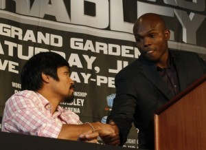 "Undefeated junior welterweight champion Manny ""Pacman"" Pacquiao of the Philippines (L) greets Timothy ""Desert Storm"" Bradley Jr. of the U.S. during a news conference in New York February 23, 2012. Pacquiao will fight Bradley for the world championship on June 9, 2012 in Las Vegas, Nevada.  REUTERS/Brendan McDermid (UNITED STATES - Tags: SPORT BOXING)"