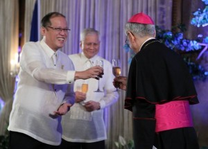 President Benigno S. Aquino III, accompanied by the Papal Nuncio to the Philippines and Dean of the Diplomatic Corps His Excellency Archbishop Guiseppe Pinto and Foreign Affairs Secretary Albert del Rosario, leads the traditional toast for the New Year's Vin d' Honneur at the Rizal Hall of the Malacañan Palace on Friday (January 11, 2014). The annual reception which marks the 27th Vin d' Honneur since the 1986 EDSA Revolution was attended by government officials, members of the Diplomatic Corps, officials of international organizations and businessmen.  (MNS photo)