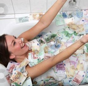 "Really?: An alleged photo of Jeane Napoles, daughter of Janet Lim-Napoles who is at the center of the pork barrel scam that involves lawmakers in the Philippines, as she is supposedly ""bathing"" in a tubful of money that has been circulating on the internet. This one was posted in en.wordpress.com."