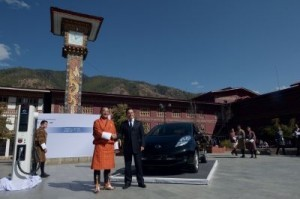 Nissan Motor Corporation chief executive officer Carlos Ghosn (R) and Bhutanese Prime Minister Tshering Tobgay shake hands after unveiling the Nissan Leaf electric vehicle in Thimphu on February 21, 2014. The remote Himalayan kingdom of Bhutan signed a deal with Japanese auto giant Nissan February 21 to become the ultimate showcase for electric cars, taking advantage of its abundance of hydropower. ©AFP PHOTO/Dibyangshu SARKAR