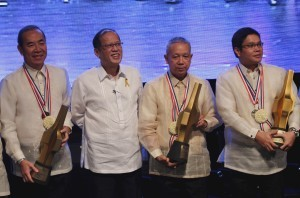 President Benigno S. Aquino III shares the stage with the 2013 The Outstanding Filipino (TOFIL) awardees Public Works and Highways Secretary Rogelio Singson for Governance and Public Service; DOST Forester Arsenio Ella for Environmental Conservation and Sustainable Development; and Dr. Alfredo Mahar Francisco Lagmay for Geology and Earth Science, for a group photo souvenir during the Awarding Ceremonies at the Insular Life Auditorium, Insular Life Corporate Center, Filinvest Corporate City in Alabang, Muntinlupa City on Wednesday (January 29, 2014). The TOFIL Award is a project of Junior Chamber International (JCI) Senate Philippines and the Insular Life Assurance Co., Limited. Having recognized outstanding Filipinos for more than two decades, TOFIL has become an institution, having developed a reputation for its selectiveness of outstanding men and women upon whom the award is conferred. It seeks to give national recognition to Filipinos whose selfless dedication to their profession or vocation has resulted in significant contributions to the welfare of their countrymen and our country at large, as well as to the advancement of their respective fields of endeavor. (Photo by Rey Baniquet / Malacañang Photo Bureau / PCOO)