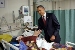 """For the President, this was one of the most poignant moments of the his first term. He was visiting wounded warriors in the intensive care unit at Bagram Air Field in Afghanistan. He had just presented a Purple Heart to Sgt. Chase Haag, who had been injured by an IED just hours before. Sgt. Haag was covered with a blanket and it was difficult to see how badly he was injured. He was also seemingly unconscious, or perhaps just asleep. The President whispered in his ear so not to wake him. Just then, there was a rustling under the blanket and Sgt. Haag, eyes still closed, reached his hand out to shake hands with the President. 'I'll never forget that moment,' someone else in the room later told me."" (Official White House Photo by Pete Souza)"