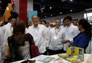 "President Benigno S. Aquino III, ushered by PTAA secretary general and Travel Tour Expo 2014 executive director Marciano Ragaza III, tours the booths during the Philippine Travel Agencies Association (PTAA) 21st Travel Tour Expo 2014 at the SMX Convention Center, Seashell Drive, Mall of Asia Complex in Pasay City on Friday(February 14) with the theme: ""Love Life, Love Travel"". The Department of Tourism is projecting 2014 tourism revenues to hit P1.4 trillion, higher by P110.6 billion of the expected earnings from domestic tourism in 2013 due in large part to a forecasted increase in the daily expenditures of domestic tourists. (MNS photo)"