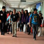 Amid global infections, DOH advises families of OFWs to stop 'fiesta-like' airport welcome