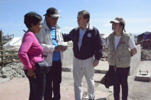 U.S. House Committee on Foreign Affairs Chairman Ed Royce and USAID staff encourage Tacloban residents whose home was completely destroyed by Typhoon Yolanda. Royce (R-CA) with seven other members of U.S. Congress visited and assured continued U.S. humanitarian support for the people of Tacloban. (MNS photo)