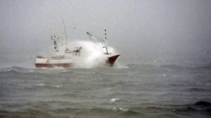 A fishing boat is hit by a wave near the coastal city of Burela, northwestern Spain, on Tuesday, Feb. 4, 2014. Spanish coastguards rescued five Filipino sailors by helicopter after the seamen's boat got caught in a storm on Tuesday off northwestern Spain, where fresh sea gales were growing, authorities said. AFP PHOTO/MIGUEL RIOPA
