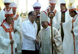 President Benigno S. Aquino III greets His Eminence Orlando Cardinal Quevedo following the Thanksgiving Mass in celebration of his elevation to the College of Cardinals at the Immaculate Conception Cathedral in Quezon Avenue, Cotabato City on Tuesday (March 11). Cardinal Quevedo received his red hat and ring from Pope Francis during a solemn consistory at the St. Peter's Basilica on February 22, 2014. (MNS photo)