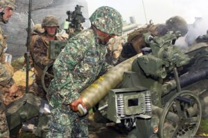 U.S. and Philippine Marines load M107 high explosive rounds into an M777A2 howitzer during an artillery shoot as part of PHIBLEX at Fort Magsaysay, Philippines, Oct. 25. PHIBLEX is a bilateral training exercise designed to improve the interoperability, readiness and professional relationships between the U.S. Marine Corps and partner nations. (U.S. Marine Corps photo by Lance Cpl. Vernon T. Meekins/Released)