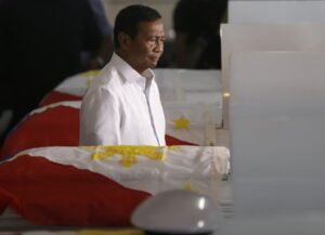 Philippine Vice-President Jejomar Binay payS tribute to seven marines killed last year in a clash with Abu Sayyaf militants in Jolo, southern Philippines, during the wake at the Philippine Marines headquarters at Fort Bonifacio in Taguig city, east of Manila, Philippines last May 27. At least seven Filipino marines and an equal number of Abu Sayyaf militants were killed in a clash in a new U.S.-backed offensive aimed at rescuing six foreign and Filipino hostages and stopping the al-Qaida-linked gunmen from staging more kidnappings in the country's south, a military commander said Sunday. (MNS photo)