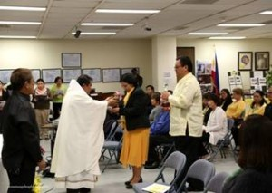 Fr. Albert Avenido receiving the offertory delivered by Consul General De La Vega and Mr.Joveno De La Vega.