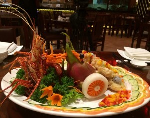 Order the lobster dish with sweet sauce made up of diced mangoes and strawberries.