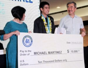 Winter Olympian Michael Martinez given a warm welcome cum a $ 10,000 cash award handed over by Ms. Carmen Linda M. Atayde, Senior Assistant Vice President and Executive Director and Hans T. Sy, Chairman Philippine Skating Union and President, SM Prime Holding Inc. at the SM Mall of Asia in Pasay City on Sunday, Feb. 23, 2014 (MNS photo)