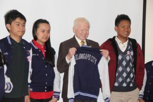 "Pinoy Pride. The Filipino students representing the country gifts Ambassador Jose L. Cuisia, Jr. with a jacket that proudly says ""Olongapo City."" (Philippine Embassy Photo by Majalya Fernando)"