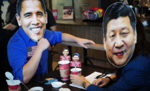 "Youth members of Akbayan Partylist wearing masks of US Pres. Barrack Obama and Chinese President Xi Jinping  ""occupied"" a coffee shop in Quezon City to draw attention to the ""occupationist ambitions"" of both the United States and China. The group is opposing the US military's enhanced defense cooperation with the Philippines and China's continuing incursions in the West Philippine Sea."