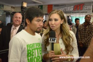 Top Rank host Crystina Poncher poses a question to Manny Pacquiao during Wednesday's Media Day at the Wild Card boxing gym in Hollywood. Pacquaio will have a rematch against Timothy Bradley at MGM Grand Garden Arena on April 12. Photo: Benny Uy
