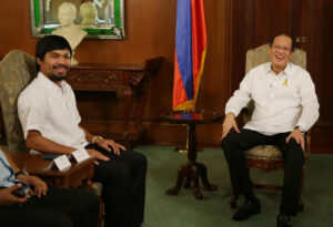 Filipino boxing hero and congressman Manny Pacquiao, left, shakes the hands of Philippine President Benigno Aquino III during his courtesy call at the Malacanang Presidential Palace in Manila Philippines on Monday, April 21, 2014. Pacquiao recently defeated American Timothy Bradley during their WBO welterweight title bout in Las Vegas. (MNS photo)