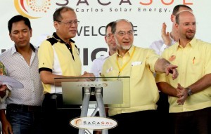 "President Benigno S. Aquino III, assisted by SACASOL's chairman Jose Maria ""Jomari"" Zabaleta and president Jose Maria ""Sech"" Zabaleta, Jr., leads the Ceremonial Switch-on of the San Carlos Solar Energy, Inc. (SACASOL) Phase I during the Inauguration Ceremony at the San Carlos Ecozone in San Carlos City, Negros Occidental on Thursday (May 15, 2014). The SaCaSol project is a greenfield, stand alone solar farm that would supply daytime base load power to the local grid throughout the entire year. It is expected to have a total gross capacity of 22 MW to be developed in two phases: Phase 1 with 13 MW and Phase 2 with 9 MW. The solar farm will provide supplemental electricity to an area of short supply and increasing demand for power. Its goal is to harness sustainable power from our planet's largest source of energy, the sun. The Project is committed to maintaining the environmental integrity of the surrounding area.  (MNS photo)"