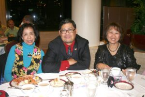 David Casuco, flanked by his best friends Myrna Aquitania and Lydia Solis of Philippine News (right).