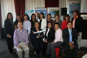 "Area Manager Marie Jemma Saranillo (second from left, seated) with her staff Account Executives Ricky Panis and Maricel Wall (5th and 6th from left respectively) in ""selfi e"" poses with Tourism Director Manny Ilagan (rightmost, seated) and travel agents during Thursday's briefi ng in Long Beach. Photo: Rhony Laigo"