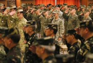 U.S. and Filipino military officers salute during the opening ceremony of the Balikatan 2014 Joint Exercise inside the Armed Forces of the Philippines (AFP) headquarters at Camp Aguinaldo in Quezon city, metro Manila May 5, 2014. According to an AFP news release, around 3,000 Filipino soldiers and 2,500 U.S. soldiers will participate in the Philippines-U.S. Balikatan 2014 military exercises which will focus on maritime security and humanitarian assistance and disaster response.  (MNS photo)
