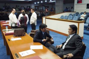 "Senator Bongbong Marcos (seated) discusses with fellow Sen. Bong Revilla (right), one of the three senators indicted in the so-called ""pork-scam."" (Photo from a Facebook Page bearing the name Senator Bongbong Marcos)"