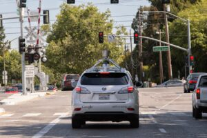 An Iconic Image for City Streets: Google's autonomous cars. Google's cars have clocked up 700,000 autonomous miles. ©Google Inc