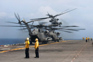 U.S. Navy CH-53E Super Stallion helicopters take off from the USS Bonhomme Richard during aviation operations exercises in the East China Sea, April 23, 2014. U.S. Navy photo by Petty Officer 2nd Class Adam D. Wainwright