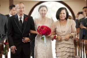 Jannelle So's parents walk on the isle (Mr. & Mrs. Perkins' Wedding by KLK Photography)