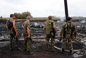 Armed pro-Russia separatists secure the site where the ill-fated Malaysia Airlines Boeing 777 flight MH17 crashed near Grabovo in Donetsk, Ukraine on Thursday, July 17. All 298 people aboard were killed in the crash, which sharply raised the stakes in a conflict between Kiev and pro-Moscow rebels. Reuters/Maxim Zmeyev