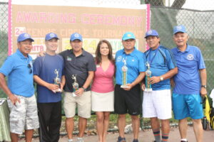 Tennis Champs:  Filipino American Chamber of Commerce of Orange County Director/Secretary Ms. Marita Jao awarded the trophies to the recently concluded 2nd Tennis Tournament of Buena Park Tennis Circle to 2014 doubles champs, DOT Director Manny Ilagan (2nd from right) and his partner to his left.  Cesar Reamico and Rico Taruc (at both extremes) coordinated the event of the one of the most active Fil-Am clubs playing at the Boisseranc Park.