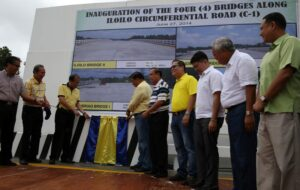 President Benigno Aquino III leads the unveiling of marker of the four bridges along iloilo circumferential road C1 during Inauguration rights held at Brgy Unka Pavia Iloilo City on friday (June 27) this is the first time Iloilo city is a recipient of such huge projects that will lead to propping up the local economy and establish the city as the next business and investment hub in the country. in photo are from Left DILG SEC Mar Roxas ,DPWH Sec. Singson, Senate President Franklin Drillon, Usec.Engr. Romeo Momo,Iloilo Governor Arthur Denfensorjr.,Iloilo City Mayor Jed Patrick Mabilog, Pavia Mayor Michael Gorriceta, and Iloilo Rep. District 2 Arcadio Gorriceta . (MNS Photo)
